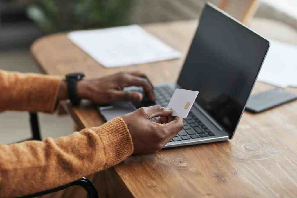 Online bill Pay Waste Partners African American Man paying Online